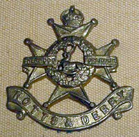 Officers' economy cap badge (1914-1919)