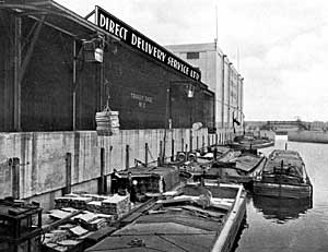 Loading barges at the Direct Delivery Ltd. warehouse in Nottingham, c.1939.